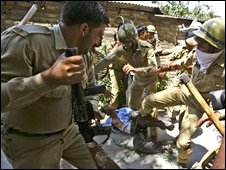 Policemen beat a Kashmiri Muslim protester during a march on Srinagar-to-Muzzfarbad road in Srinagar August 11, 2008