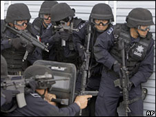 Mexican federal police demonstrate a hostage rescue operation during the visit of Senator John McCain in July