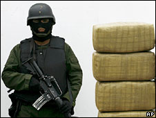 Mexican soldier stands by piles of confiscated marijuana - file photo