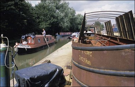 Canal boat being repaired at the boatyard