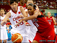 Tina Thompson (right) in action for the US