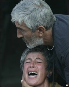 An unidentified crying Georgian woman is calmed by her husband in Gori