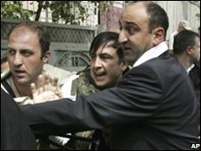 Bodyguards escort Georgian President Mikhail Saakashvili, centre in Gori, Georgia