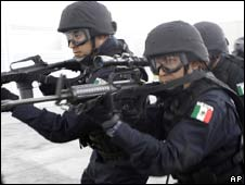 Mexican federal police take part in a simulated hostage rescue mission - file photo