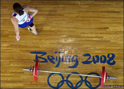 Welsh weightlifter Michaela Breeze holds her injured back in Beijing