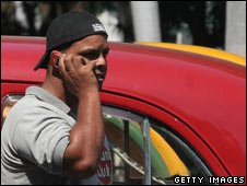 Man using a mobile phone in Havana, Cuba