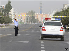 Police tape seals off the scene of one of the attacks in Kuqa on 10 August 2008