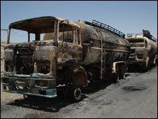 Burned out trucks on the road near Kabul