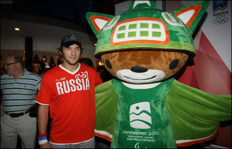 Russian hockey star Alexander Ovechkin with the Vancouver-2010 mascot