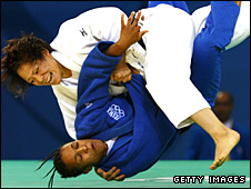 Ayumi Tanimoto throws France's Lucie Decosse