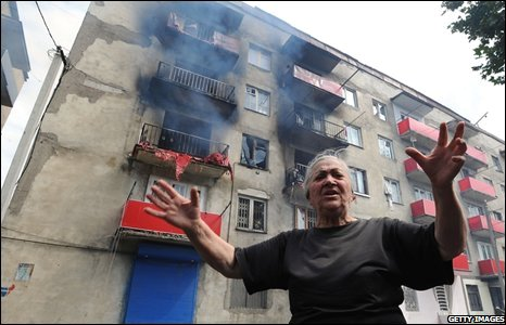 A woman cries after her house was hit by a shell in Gori, Georgia