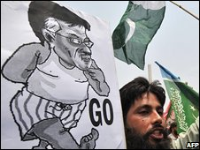 Protester with a caricature of President Musaharraf