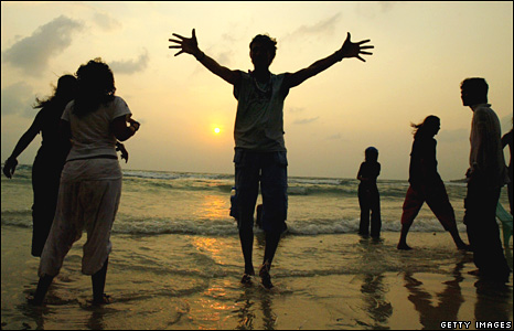 Revellers on the beach for sunrise at Koh Phan Ngan's Full Moon Party