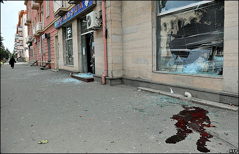 Blood stains a pavement in Gori after an artillery strike on 12 August