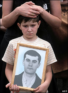 Artur, a son of Russian soldier Oleg Golovanov killed in Tskhinvali, attends his funeral  in  Zavodsky  on 12 August