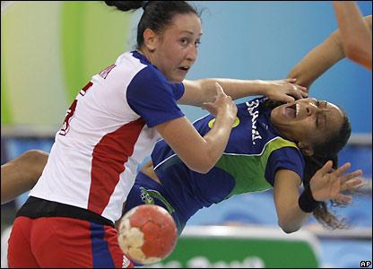 Russias Liudmila Postnova wins a tackle
