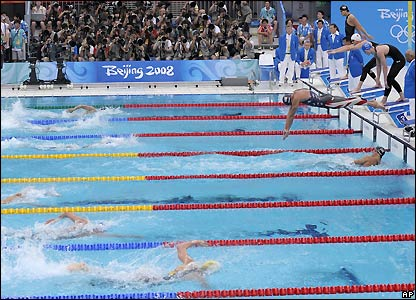 Phelps finishes his leg as Ryan Lochte starts his