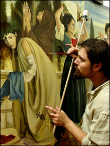Luca Battini in front of his fresco