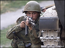 Russian soldier taking cover on way into Tskhinvali, South Ossetia, 11 Aug 08