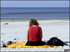 Woman reading on a beach