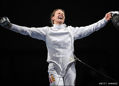 Germany's Britta Heidemann is overwhelmed as she beats Romania's Ana Maria Branza to gold in the women's individual epee