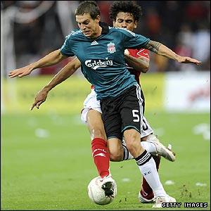 Igor De Camargo shadows Liverpool defender Daniel Agger