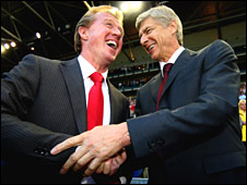 Steve McClaren embraces Arsene Wenger as their sides meet in Arnhem
