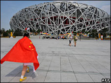 A fan wears a Chinese flag outside the Bird's Nest stadium on 12 August 2008