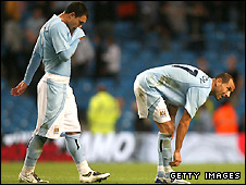 Valeri Bojinov and Martin Petrov were left dejected by City's shock defeat