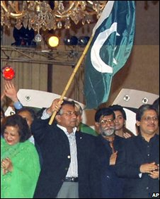 President Musharraf with the Pakistani flag