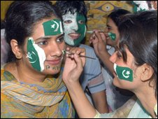 Pakistani students paint National flags on the faces