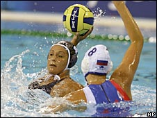 Brenda Villa of the United States winds up to shoot as Russian Evgenia Soboleva tries to block her