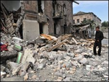 A man stands near his destroyed home in Gori, Georgia