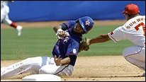 Chinese Taipei's Lin Che-Hsuan, left, is tagged out at third by China's third baseman Sun Wei