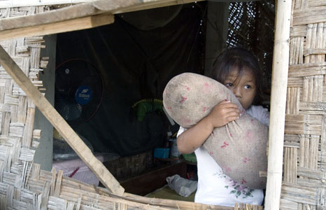 A Cambodian girl at a resettlement village for people evicted from a slum on the outskirts of Phnom Penh, Cambodia.