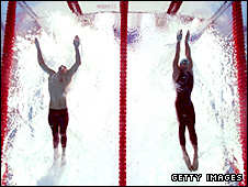 Michael Phelps and Milorad Cavic surge for the wall at the end of the race