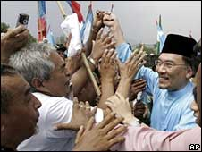Malaysian opposition leader Anwar Ibrahim is greeted by supporters on Saturday