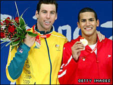 Grant Hackett and Oussama Mellouli pose with their medals