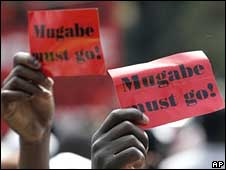 Protesters demand the removal of Zimbabwean President Robert Mugabe outside the meeting of the Southern African Development Community (SADC) in Johannesburg, South Africa, on Saturday
