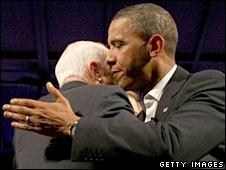 John McCain and Barak Obama hug each other