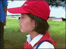 "North Korean girl wearing cap with Nike ""swoosh"" (pic courtesy North Korean Economy Watch)"