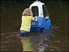 Young girl in flood water (picture by David Cleland)