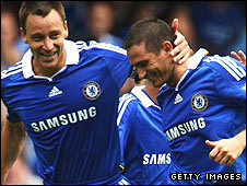 John Terry congratulates Frank Lampard after his penalty