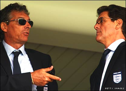 Fabio Capello manager of England looks on with fitness coach Massimo Neri (L)