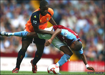 Micah Richards of Manchester City battles with Ashley Young of Aston Villa