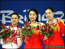 Julia Pakhalina, Guo Jingjing and Wu Minxia show off their medals for the women's 3m springboard event in Beijing, in which Guo became the most successful woman diver in Olympic history