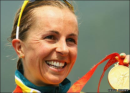 Australia's Emma Snowsill celebrates with her gold medal after victory  in the women's triathlon
