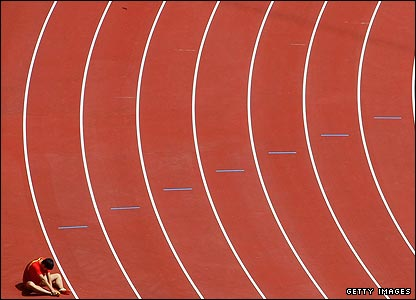 China's Liu Xiang sits on the track
