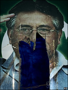 A torn poster of Pervez Musharraf