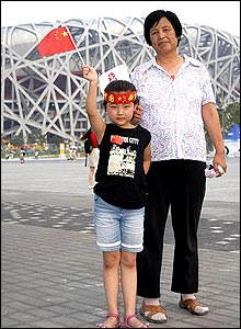 A grandmother and grandaughter proudly pose outside the National Stadium